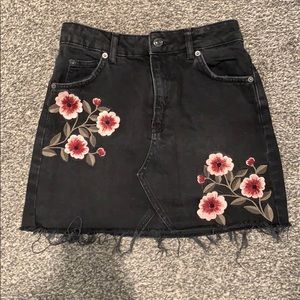 Black denim skirt with floral design